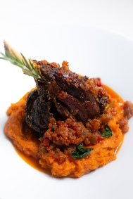 Braised Lamb Shank on a bed of sauteed spinach and yam pottage puree